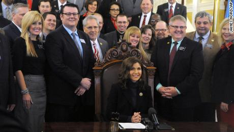 Gov. Kristi Noem signs her first bill into law on Thursday,  allowing people to carry concealed pistols without a permit in South Dakota.