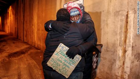 The Salvation Army's Richard S. Vargas hugs Alvin Henry during a cold wellness checkup in Chicago.