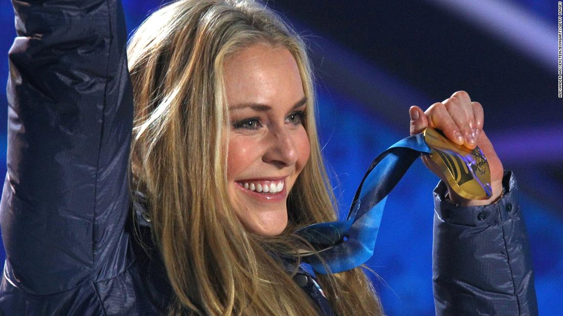 Vonn celebrates with her gold medal after the Olympic downhill.