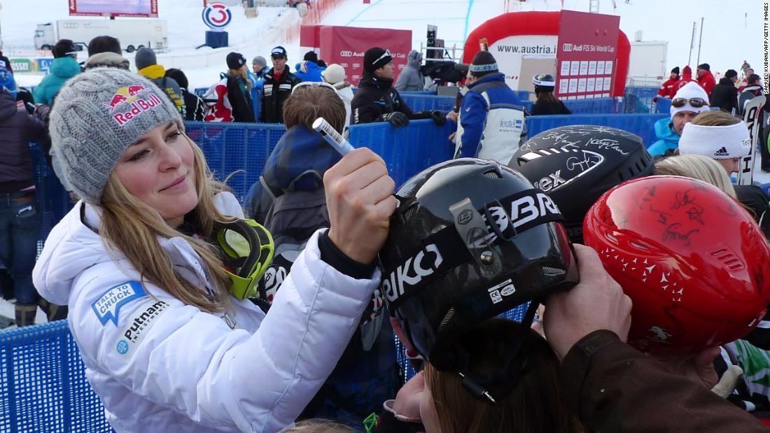 Vonn signs autographs at a World Cup venue in January 2011.