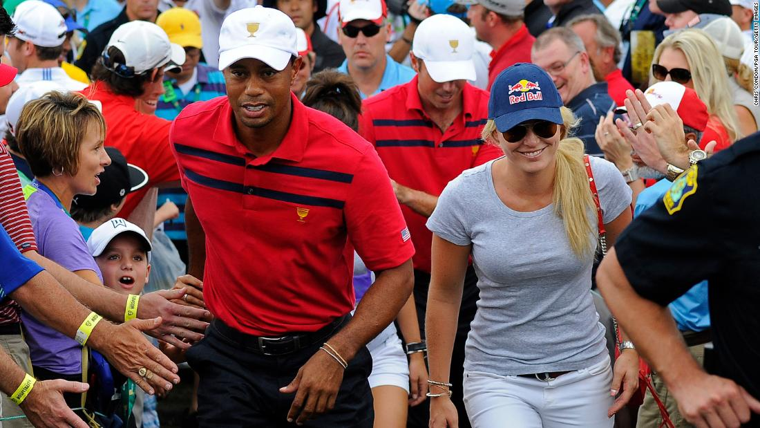 Woods and Vonn walk together at the Presidents Cup in October 2013.