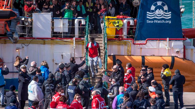 Migrants aboard the Sea-Watch 3 vessel disembark in the port of Catania on January 31.