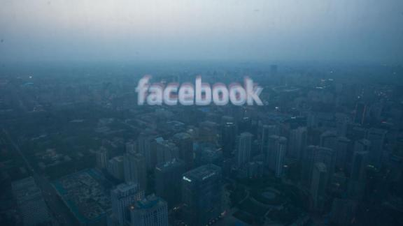 A photo taken on May 16, 2012 shows a computer screen displaying the logo of social networking site Facebook reflected in a window before the Beijing skyline. With investors hungry for Facebook shares ahead of a hotly anticipated offering, the social network unveiled a 25 percent increase in the number of shares to be sold at the market debut. AFP PHOTO / Ed Jones / AFP PHOTO / Ed Jones        (Photo credit should read ED JONES/AFP/Getty Images)