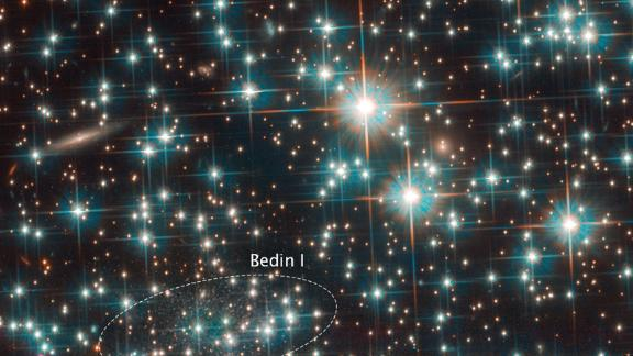 The Hubble Space Telescope found a dwarf galaxy hiding behind a big star cluster that