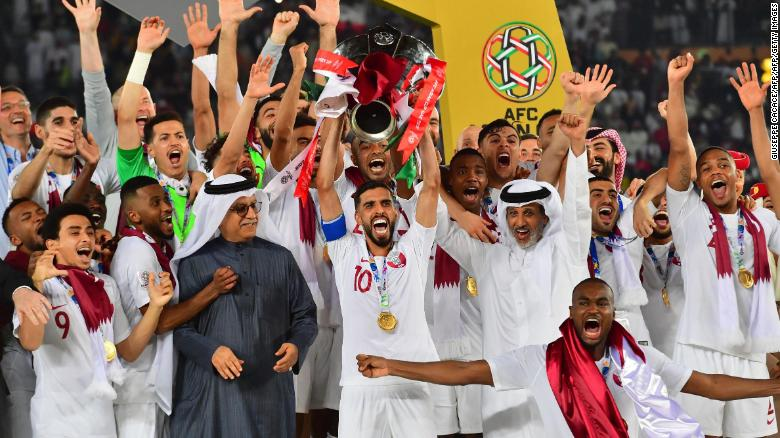 Qatar holds the Asian Cup aloft after beating Japan 3-1 in the final.