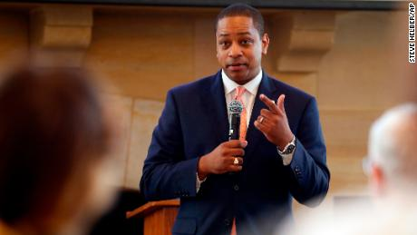 Virginia Lt. Gov. Justin Fairfax gestures during remarks before a meeting of the Campaign to reduce evictions at a church meeting room in Richmond, Va., Tuesday,Sept. 25, 2018. (AP Photo/Steve Helber)