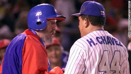 Castro talks with  Chavez before a friendly baseball game between the Cuban and Venezuelan teams, in Venezuela in 2000.