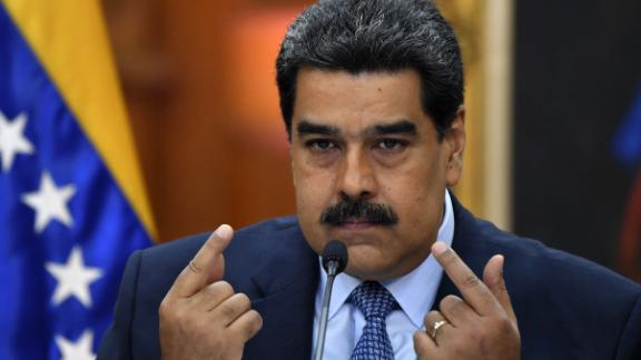 Venezuela's President Nicolas Maduro speaks during a press conference, where he warned the Lima Group that he would take energetic measures if they do not rectify their position on Venezuela in 48 hours, on the eve of assuming a new six-year mandate, at the Miraflores presidential palace in Caracas, Venezuela on January 9, 2018. - Last week the Lima Group -- made up of 14 mostly Latin American countries -- had urged Maduro to renounce his second term and deliver power to parliament, a demand Caracas blasted as incitement to stage a coup d'etat. (Photo by YURI CORTEZ / AFP)        (Photo credit should read YURI CORTEZ/AFP/Getty Images)