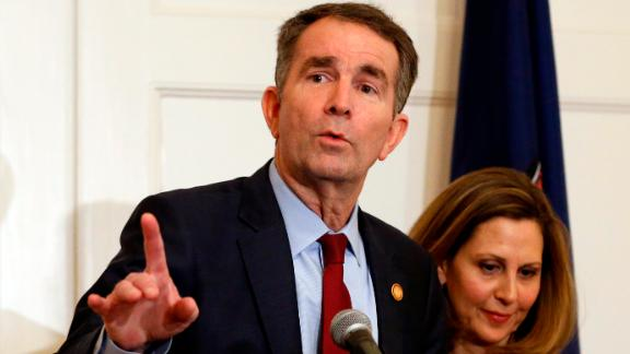 Virginia Gov. Ralph Northam, left, gestures as his wife, Pam, listens during a news conference in the Governors Mansion at the Capitol in Richmond, Va., Saturday, Feb. 2, 2019. Northam is under fire for a racial photo the appeared in his college yearbook. (AP Photo/Steve Helber)