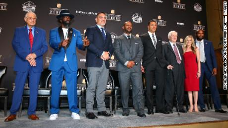 The 2019 Pro Football Hall of Fame class pose for a photo. From left to right: Johnny Robinson, Ed Reed, Kevin Mawae, Ty Law, Tony Gonzalez, Gil Brandt, Annabel Bowlen for Pat Bowlen and Champ Bailey.