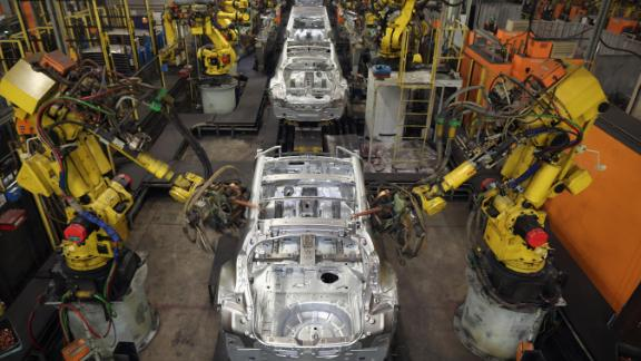 SUNDERLAND, ENGLAND - JANUARY 24:  Robotic arms assemble and weld the body shell of a Nissan car on the production line at Nissan