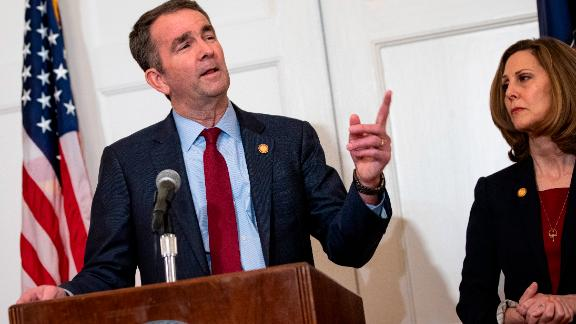 Virginia Governor Ralph Northam, flanked by his wife Pam, speaks with reporters at a press conference at the Governor's mansion on February 2, 2019 in Richmond, Virginia.