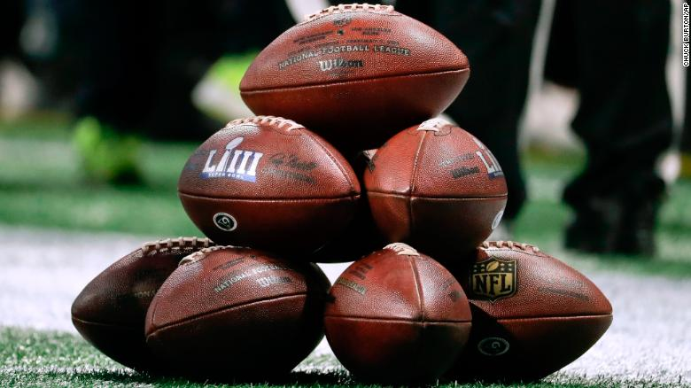 Game balls are stacked on the field before the game.