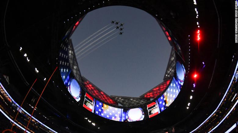 Air Force jets fly over Mercedez-Benz Stadium before the start of the game.