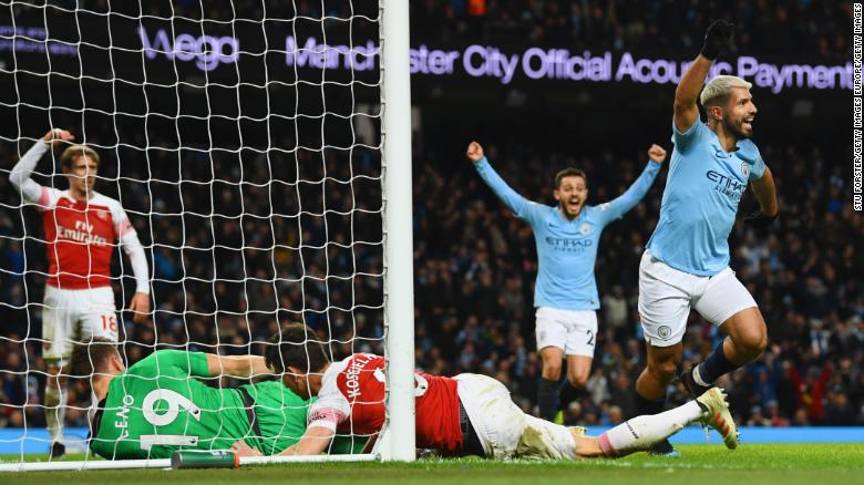 Sergio Aguero of Manchester City (right) celebrates after scoring his team's third goal during the Premier League match between Manchester City and Arsenal FC at Etihad Stadium on Sunday. Aguero has scored 219 career goals for City, a team record.