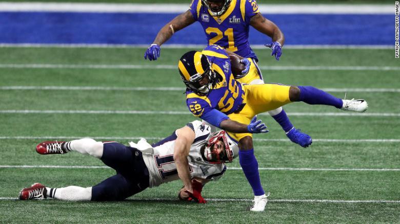 Rams linebacker Cory Littleton intercepts Brady's first pass of the game.