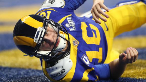 Goff looks up after throwing a pass from his own end zone.