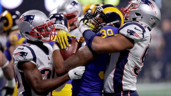 Rams running back Todd Gurley II is tackled by McCourty, left, and Deatrich Wise Jr. in the second half.