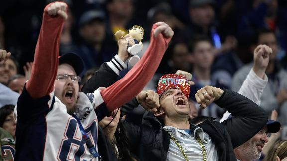 Patriots fans cheer during the second half.
