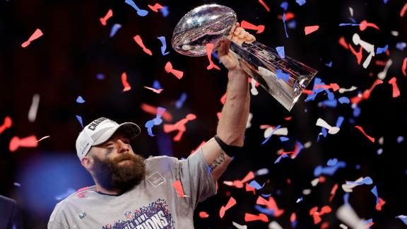 Patriots wide receiver Julian Edelman, the game's Most Valuable Player, holds up the Lombardi Trophy.