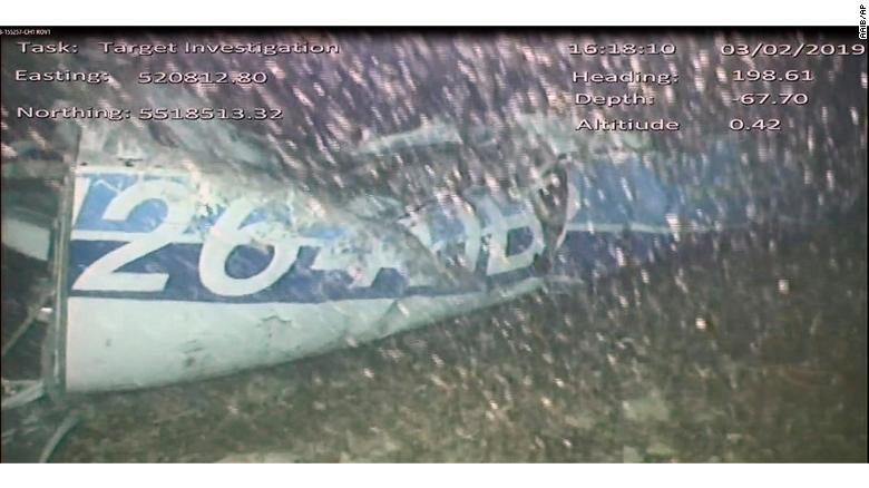 An image released Monday Feb. 4 by the UK Air Accidents Investigation Branch (AAIB) showing the rear left side of the fuselage including part of the aircraft registration N264DB