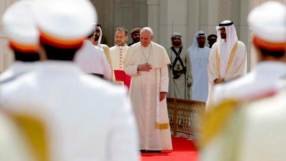 Pope Francis arrives for an official welcome ceremony at the Presidential Palace, in Abu Dhabi, United Arab Emirates, Monday, Feb. 4, 2019. Francis has arrived at the presidential palace to officially start his historic visit to the United Arab Emirates as canons boomed and a military aircraft flew over trailing the yellow and white smoke of the Holy See flag. At right is Crown Prince Sheikh Mohammed bin Zayed Al Nahyan. (AP Photo/Andrew Medichini)