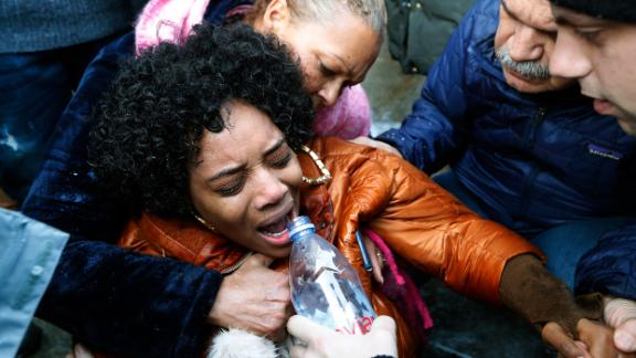 Yandy Smith receives aid after being pepper sprayed at the prison on Sunday.