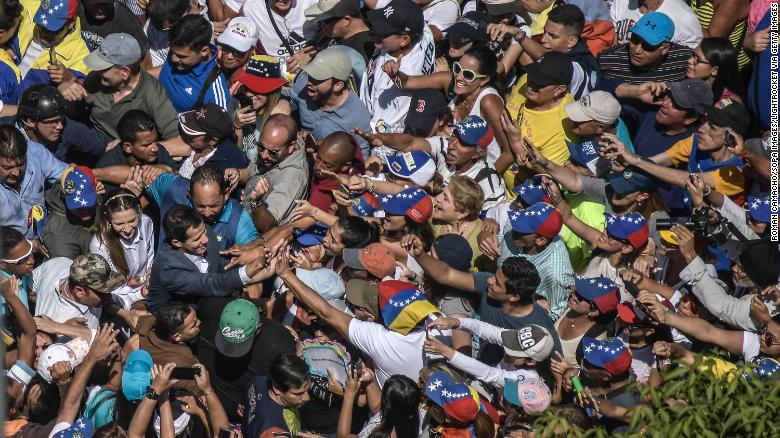 A crowd surrounds Juan Guaido during a protest against Maduro on Saturday.