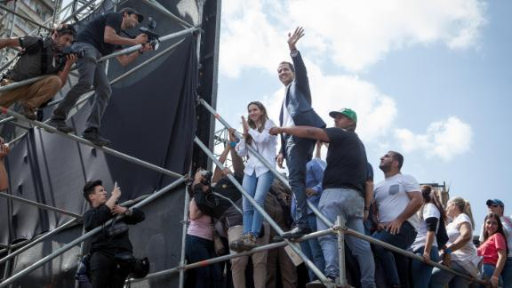 Juan Guaido waves to thousands of his at a rally in the capital Caracas on Saturday.