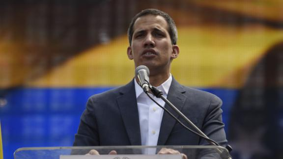 Opposition leader Juan Guaido delivers a speech during a gathering with thousands of supporters in Caracas on February 2, 2019. - Tens of thousands of protesters were set to pour onto the streets of Caracas to back self-proclaimed acting president Guaido