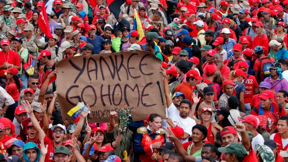 Supporters of President Nicolas Maduro hold up an anti-American banner during a rally in Caracas, Venezuela, Saturday, Feb. 2, 2019. Maduro called the rally to celebrate the 20th anniversary of the late President Hugo Chavez's rise to power. (AP Photo/Ariana Cubillos)