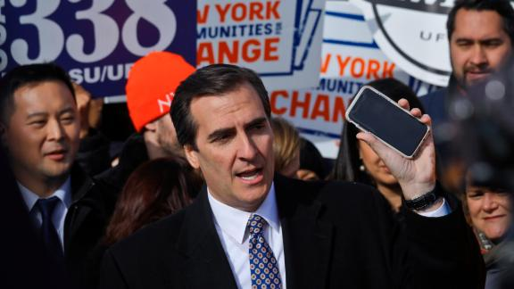New York State Sen. Michael Gianaris, center, calls on supporters to remove the Amazon app from their phones and boycott the compony, as he address a coalition rally and press conference Wednesday Nov. 14, 2018, in New York. (AP Photo/Bebeto Matthews)
