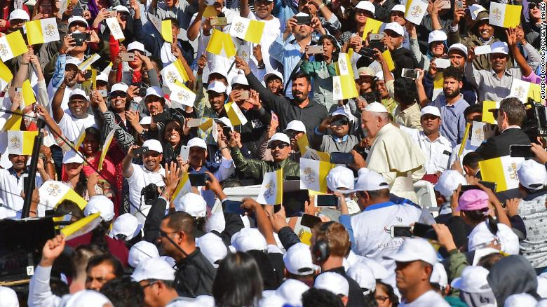 Pope Francis greets crowds as he arrives Tuesday.