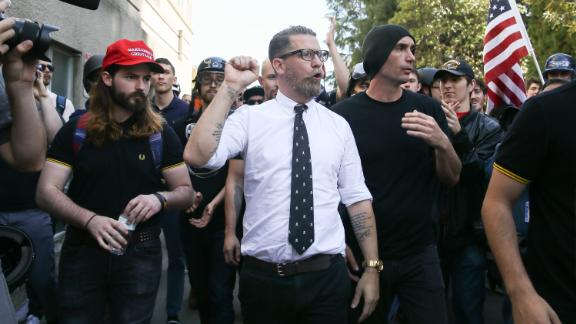 Right-wing provocateur Gavin McInnes pumps his fist during a rally  in Berkeley, California.