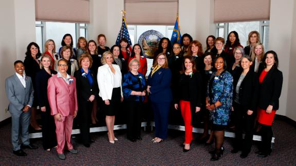 Thirty-two female members of the Nevada Legislature pose before the start of the state's legislative session in Carson City on Monday. The group represents the first female-majority legislature in the country.
