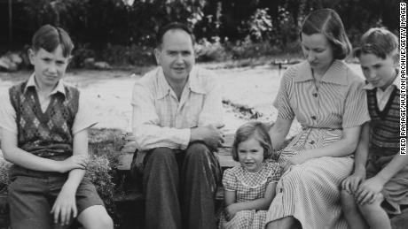 Australian physicist Eric Burhop (1911 - 1980), secretary to the Atomic Scientists' Committee of the Association of Scientific Workers, with his family at their home in Surbiton, London, 22nd July 1951. Burhop's passport has been cancelled by the British government due to his plans to travel to the Soviet Union. He is pictured with his wife Winifred and children (left to right) Graham, Annalise and Ian. (Photo by Fred Ramage/Keystone/Hulton Archive/Getty Images)