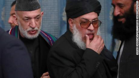 Afghanistan's former president Hamid Karzai (L) and the Taliban's chief delegate Sher Mohammad Abbas Stanikzai at the conference on Afghanistan in Moscow on Tuesday.