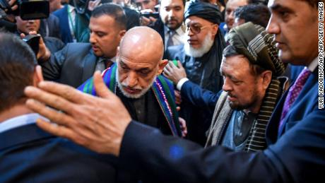 Former Afghan president Hamid Karzai arrives at the Moscow conference Tuesday.