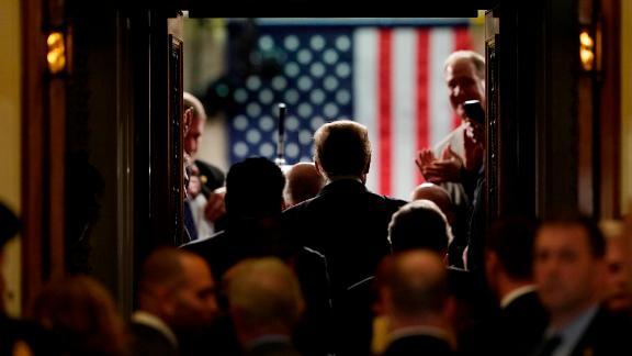 Trump walks into the House chamber.