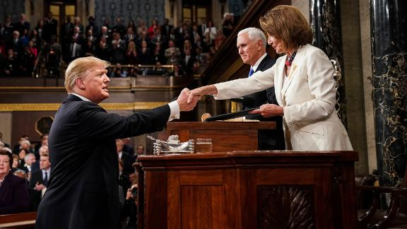President Donald Trump shakes hands with House Speaker Nancy Pelosi before delivering his State of the Union address on Tuesday, February 5.