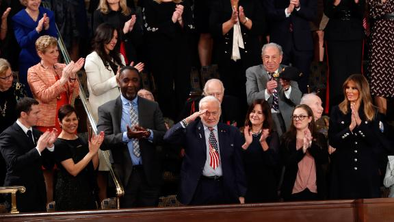 """Former NASA astronaut Buzz Aldrin salutes as he is recognized by Trump during his speech. Trump thanked the Apollo 11 astronaut before saying, """"This year, American astronauts will go back to space on American rockets."""""""