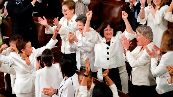 """A group of Democratic women, dressed in all white, stands to cheer during a portion of Trump's speech. Trump was discussing women in the workforce when the moment happened. """"No one has benefited more from a thriving economy than women who have filled 58% of the newly created jobs last year,"""" Trump said. After the Democrats stood up, Trump joked: """"You weren't supposed to do that. Thank you very much."""" The House Democratic Women's Working Group had invited female members of both parties to wear white as a symbol of solidarity."""