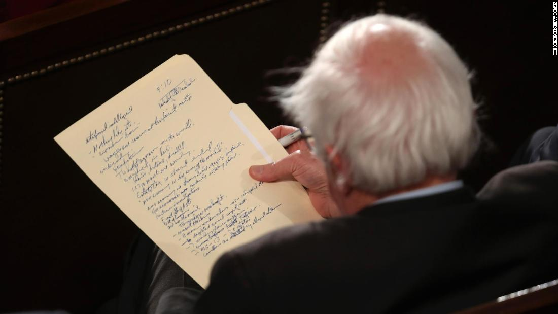 Sanders looks at his notes as he watches President Trump deliver the State of the Union address in February 2019.