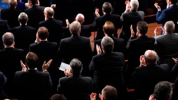 Lawmakers applaud during Trump's speech.