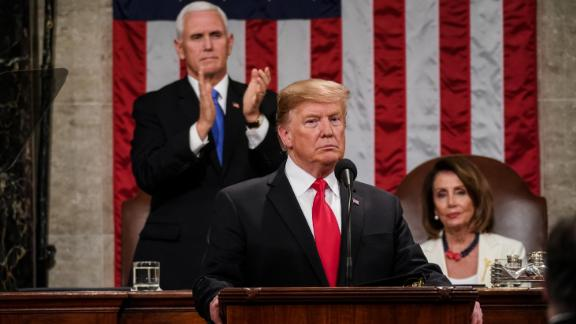 Pence applauses part of Trump's speech while Pelosi remains sitting.