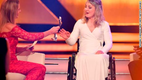 Vogel receives her award at the German athlete of the year ceremony from TV presenter  Katrin Mueller-Hohenstein.