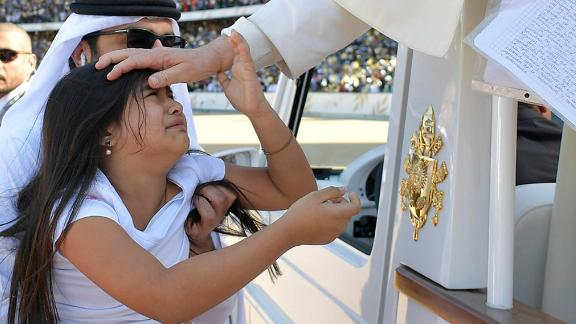 Pope Francis blesses a child before celebrating a mass at Zayed Sports City Stadium in Abu Dhabi, United Arab Emirates, February 5, 2019. Vatican Media/Handout via REUTERS  ATTENTION EDITORS - THIS IMAGE WAS PROVIDED BY A THIRD PARTY.