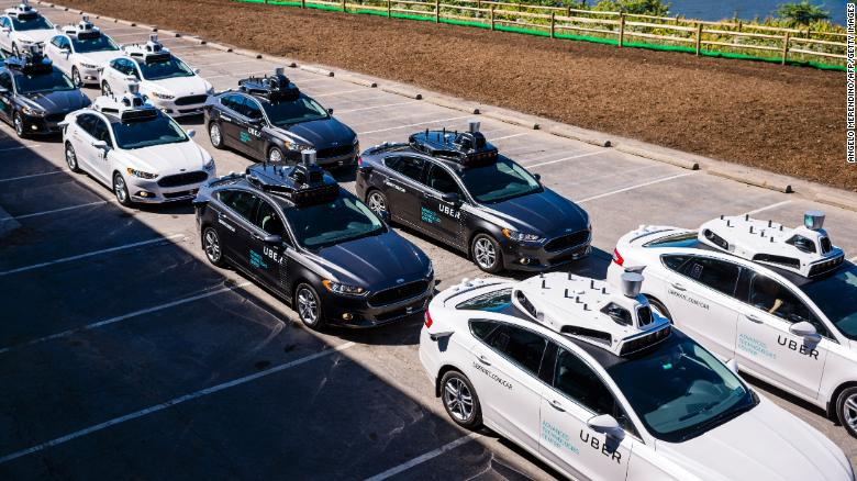 Pilot models of the Uber self-driving car on display in 2016.