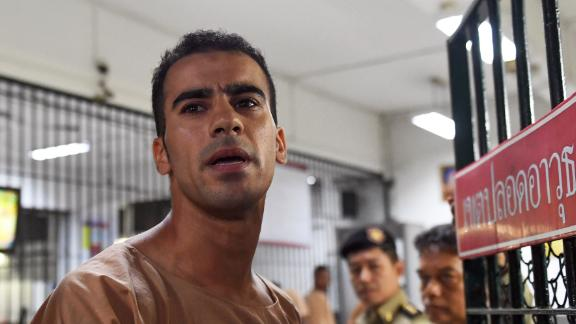 TOPSHOT - Hakeem al-Araibi, a Bahraini refugee and Australian resident, is escorted to a courtroom in Bangkok on February 4, 2019. - Hakeem al-Araibi, who was detained by Thai immigration authorities in late November 2018 after arriving in Bangkok for a vacation with his wife, fears torture and even death if he is returned to his homeland. (Photo by Lillian SUWANRUMPHA / AFP)        (Photo credit should read LILLIAN SUWANRUMPHA/AFP/Getty Images)