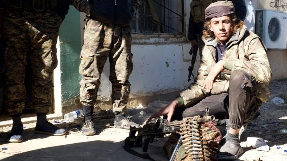 Arab fighters from the  Shuaitat tribe take positions around ISIS